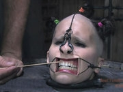 Marina is the bitch in the barrel. It leaves her head open for any kind of torment. PD gets creative and makes a gag fit for the circus. In a feat only fit for Real Time Bondage PD threads a line thro