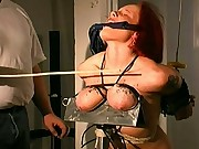 Sometimes I like to make my slave get on her knees during her breast bondage session. Pouring red hot candle wax all over her bound tits really does put a smile on my face.  I even like to dress her u