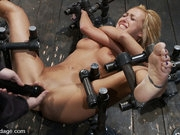 Skinny hot blond with great tits, bound in hard metal and made to squirt!!!