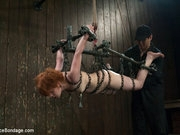 Cute little Juliette suspended in chain metal hogtie cumming like a fucking wild beast.