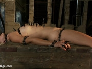 Adorable whore Chloe Camilla chained to a box, cruelly fucked with, and cumming hard.